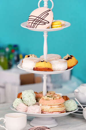 Cake stand with different sweets and tea Stock Photo