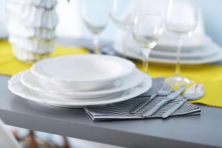 Table served with dishes, close up