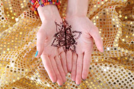 Henna tattoo on female hands, top view Stock Photo