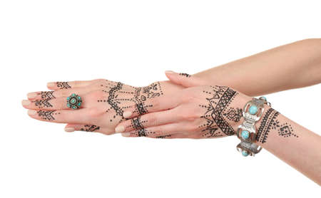 Henna tattoo on female hands isolated on white Stock Photo