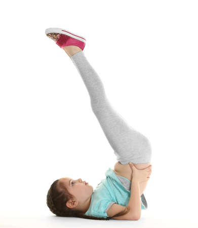 Little cute girl practicing yoga pose, isolated on white 写真素材 - 95741553