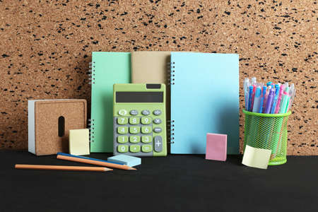 Stationery on black wooden table. Stock Photo