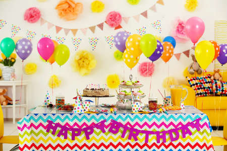 Colorful dessert table with decoration for child birthday