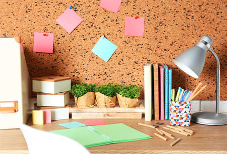 Workplace with stationery on light wooden table. Stock Photo