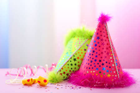 Party hats on bright background Stock Photo