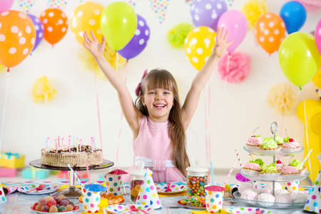 Happy cute little girl at birthday party