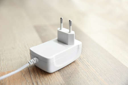 Power plug on wooden floor