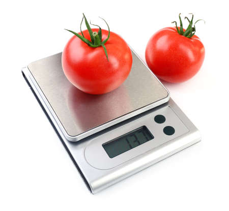 Two tomatoes with digital kitchen scales, isolated on white Stockfoto