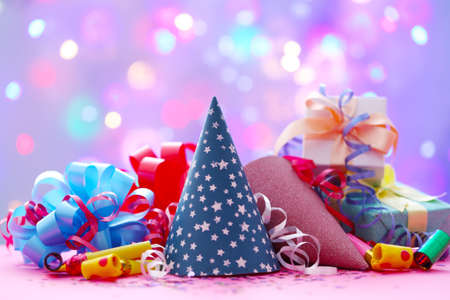 Party hats and other stuff on blurred garland background 版權商用圖片