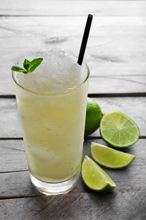 Glass of lemon soda with crushed ice and fresh mint on rustic wooden background 스톡 콘텐츠
