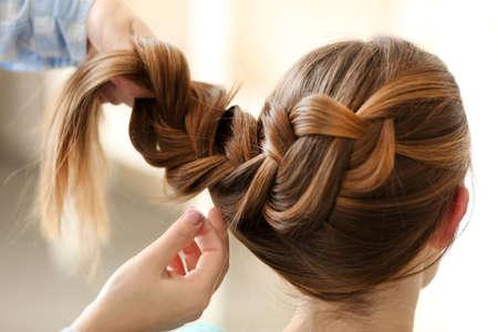 Woman making braids