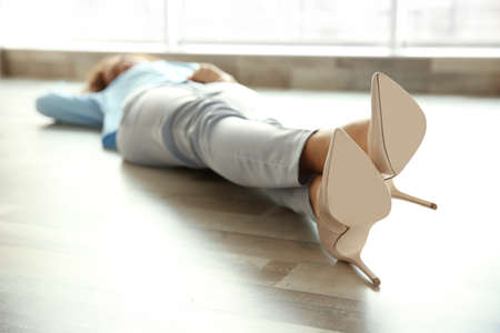 Young business lady lying on the floor Stock Photo