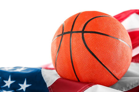Basketball with American flag, isolated on white. Popular sport concept