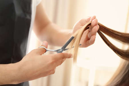 Professional hairdresser making stylish haircut Stock Photo