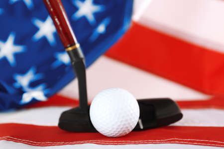 Golf ball and club on background of American flag. Popular sport concept Stock Photo