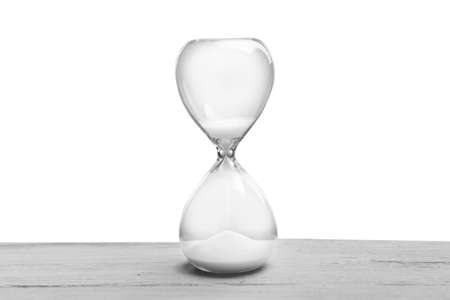 Hourglass on grey background Foto de archivo