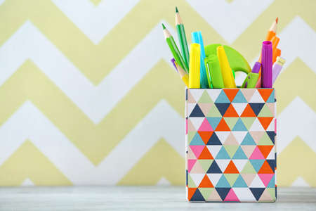 Stationery in box on color background Stock Photo