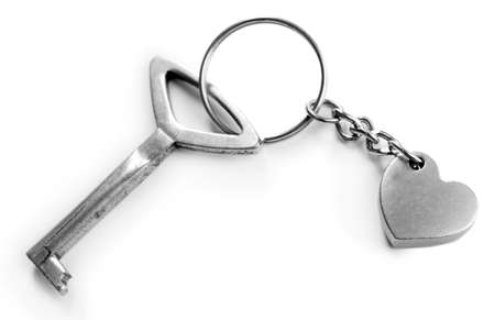 Key with heart trinket, isolated on white Stock Photo