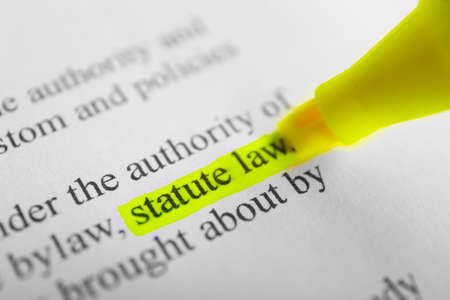 Words Statue law highlighted with a yellow marker