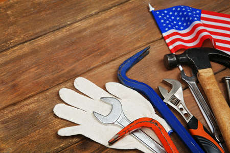 Working tools  on a wooden background. Labor day concept.