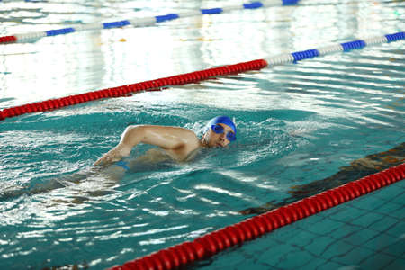 Sporty young man swimming in the pool