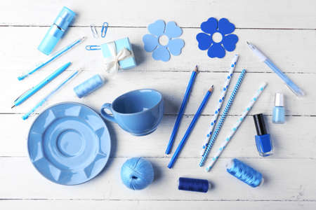 Blue colour flat lay composition on white wooden background 스톡 콘텐츠