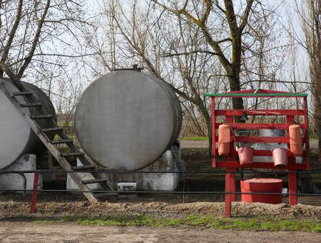 Big metal watering tanks.