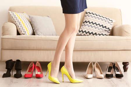 Woman choosing right shoes.
