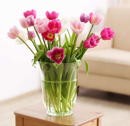 Bouquet of beautiful tulips in room interior