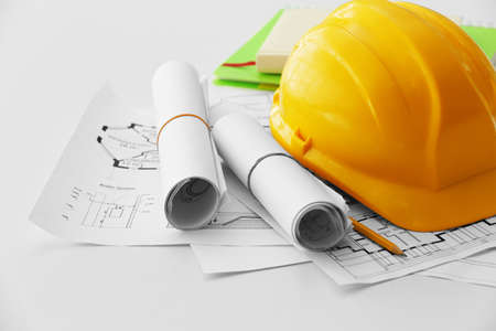 Yellow helmet on the table with blueprints Stock Photo