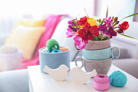 Beautiful freesia flowers on table in room Stock Photo