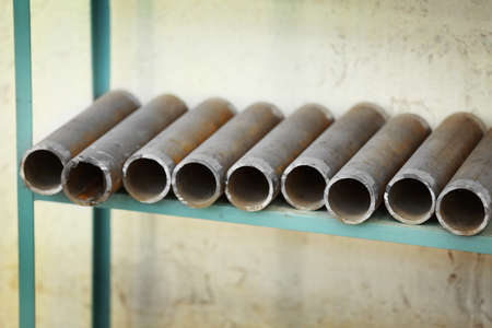 Copper industrial tubes on the shelf Stock Photo