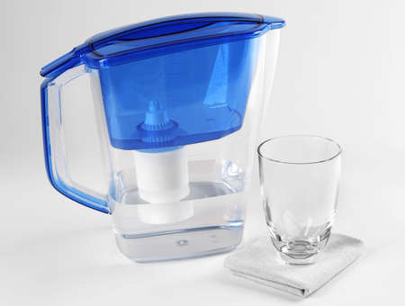 Filter and glass of water on napkin isolated on white