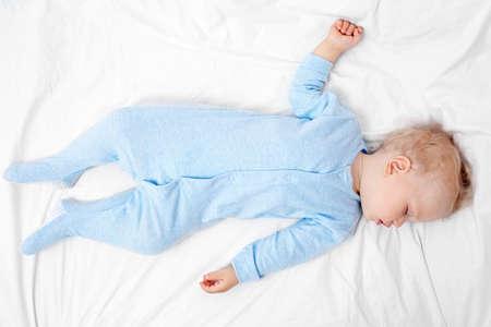 Baby sleeping on bed Stock Photo - 98547347
