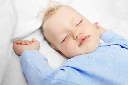 Baby sleeping on bed