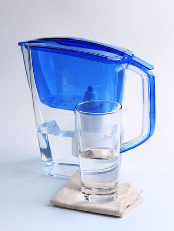 Filter and glass of water isolated on white Foto de archivo