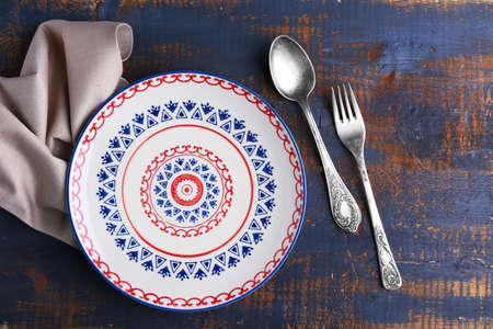 Set of dinnerware on wooden table Stock Photo