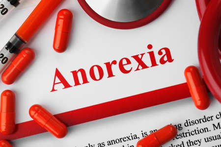 Anorexia concept. Medical supplies on paper background Archivio Fotografico