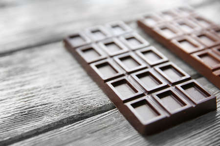 Chocolate bars  on wooden background