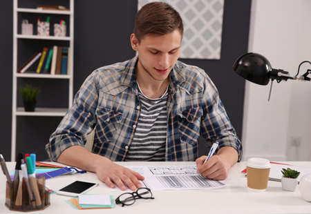 Man working with drawings at office