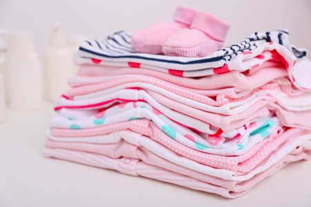 Baby clothes for newborn on white table Stock Photo