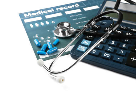 Calculator and medical stethoscope on light background