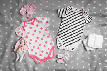 Baby clothes for newborn on grey blanket Stock Photo