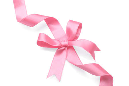 Pink ribbon with bow on white background Foto de archivo