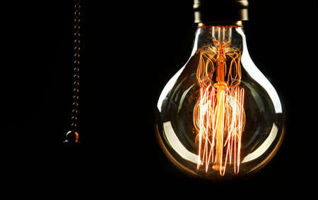 Light bulb on black background, close up Stock Photo