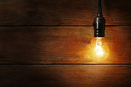Light bulb on wooden background, close up 写真素材