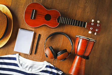 Musician set on brown wooden background Stock Photo - 95896125
