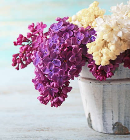 Fresh lilac on wooden background 스톡 콘텐츠