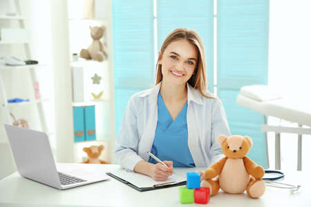 Young beautiful female doctor working at the office Stock Photo