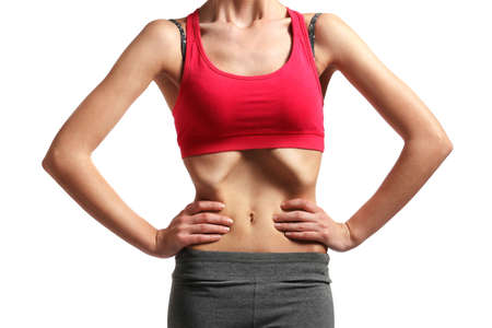 Belly of young woman with anorexia on white background Banque d'images